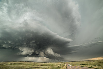 Supercell structure and a lightning, igniting grass fire, Carr, northern Colorado, USA - p429m1494508 by Jessica Moore