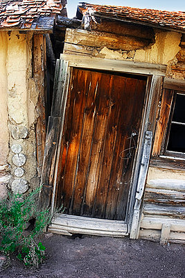 Abandoned house with door - p4424369f by Design Pics