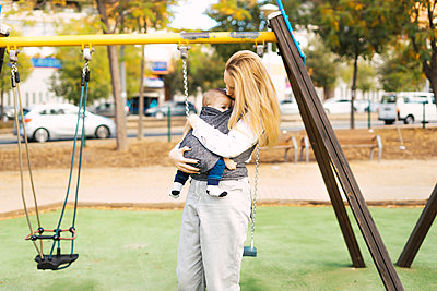Happy mother with baby boy on a playground - p300m2155962 by Eloisa Ramos