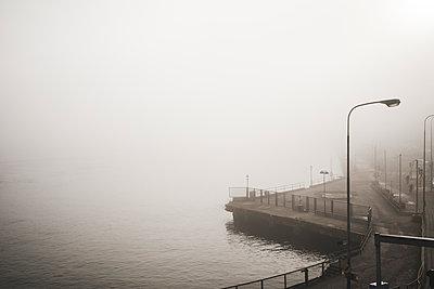 Waterfront in fog - p312m1147417 by Henrik Kindgren
