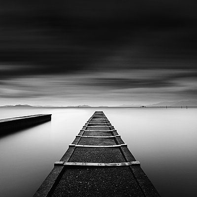 Long exposure shot of jetty and dramatic clouds, Lake Biwa, Shiga Prefecture, Japan - p1166m2201368 by Cavan Images
