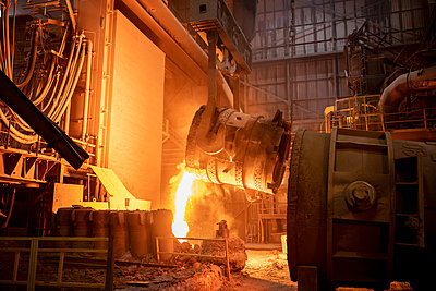 Waste steel pouring away from flask in steelworks - p429m2135013 by Monty Rakusen