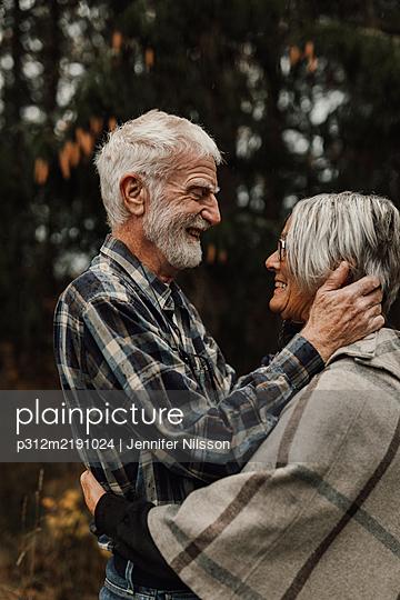 Happy senior couple together - p312m2191024 by Jennifer Nilsson