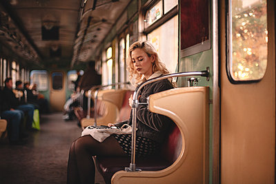 Young cute woman traveling in subway train - p1166m2153515 by Cavan Images