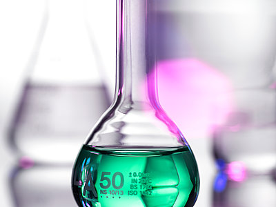 Laboratory beakers containing chemical formulas - p429m2050976 by Andrew Brookes