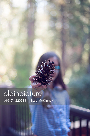 Girl with Pinecone in Hand - p1617m2205991 by Barb McKinney