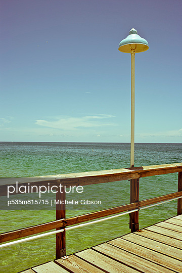 Lamp post on a pier in Florida - p535m815715 by Michelle Gibson