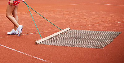 Cleaning the tennis court I - p606m856067 by Iris Friedrich