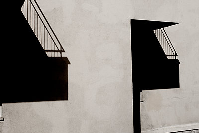 Shadow of staircase on house wall - p1462m1515766 by Massimo Giovannini