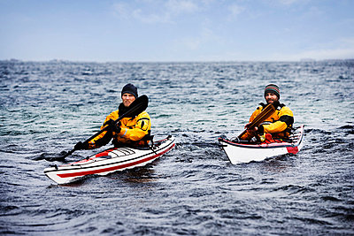 Two men kayaking - p42913672f by Soren Hald