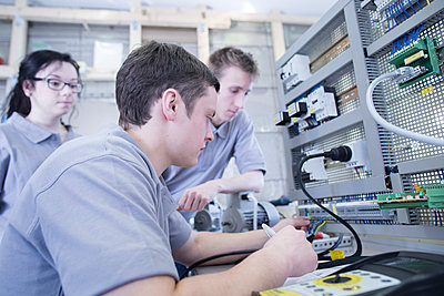 Students at electronics vocational school - p300m998267f by Sigrid Gombert