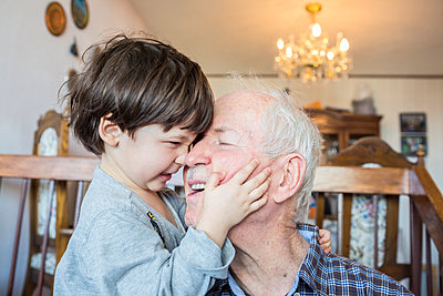 Grandfather and grandson - p535m1004188 by Michelle Gibson