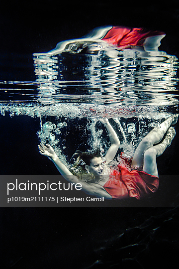 Woman falling into water - p1019m2111175 by Stephen Carroll