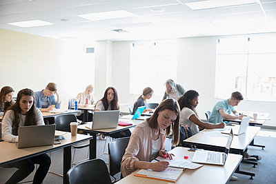 Professor and students studying in classroom - p1192m1473204 by Hero Images