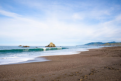 Scenic view of beach against sky - p1166m1474338 by Cavan Images