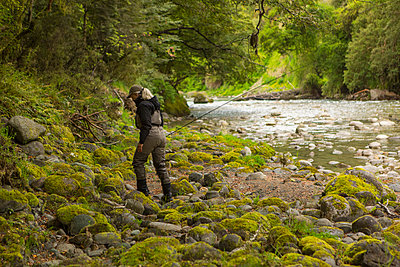 Caucasian woman walking in remote river - p555m1312271 by Steve Smith