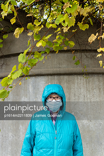 Woman in mask - p1614m2211839 by James Godman