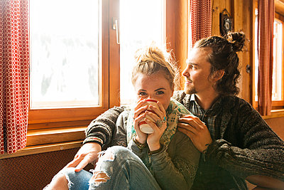 Couple in a mountain cabin - p1142m1035030 by Runar Lind