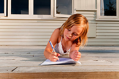 Girl on porch, drawing a picture - p924m665064f by Flashgun