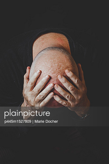Bald Head in hands - p445m1527809 by Marie Docher