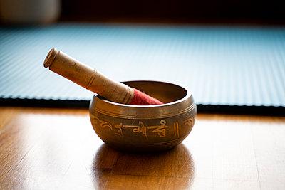 Tibetan brass bowl on floor - p300m2281377 by VITTA GALLERY
