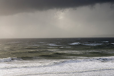 Storm clouds and ocean, Manu Bay. - p1201m1589904 by Paul Abbitt