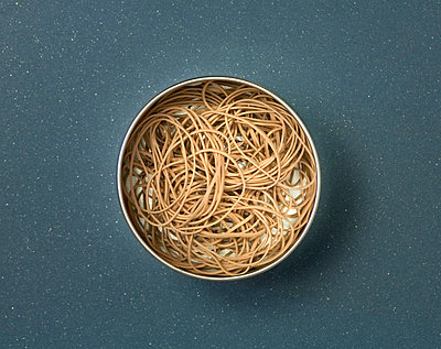 Rubber bands in metal tin   - p4423993f by Design Pics