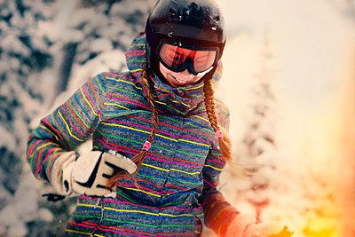 Caucasian girl wearing helmet and goggles in winter - p555m1412623 by Vladimir Serov