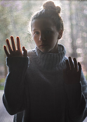 Girl with Hands on Screen - p1503m2015895 by Deb Schwedhelm