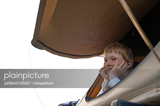 Boy in mobile home on camping site - p236m2193327 by tranquillium