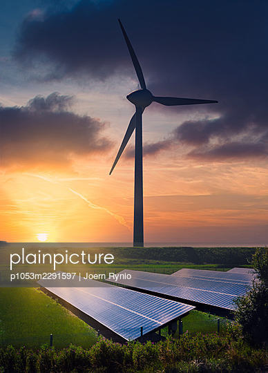 Wind Turbines and solar panels at sunset - p1053m2291597 by Joern Rynio