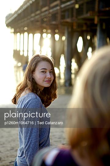 Girls on pier - p1260m1064716 by Ted Catanzaro