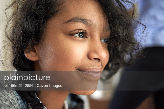Portrait of a beautiful young teen mixed race girl - p1166m2112856 by Cavan Images