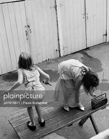 Girls dancing on picnic table - p37815871 by Paula Bullwinkel