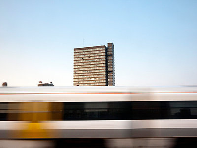 Skyscraper through train window - p3883172 by Weather