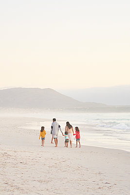 Family walking on ocean beach, Cape Town, South Africa - p1023m2200928 by Trevor Adeline