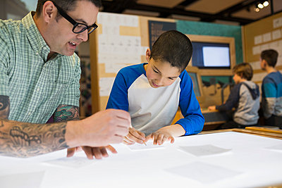 Teacher and student tracing light table science center - p1192m1019848f by Hero Images