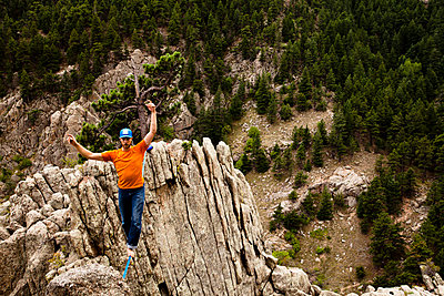 A male highliner walks the Elephant Buttresses highline in Boulder Canyon - p343m801175f by Kyle Sparks