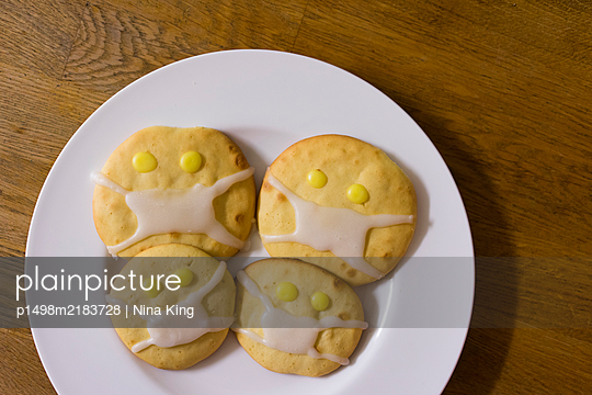 Cookies with icing on a plate - p1498m2183728 by Nina King
