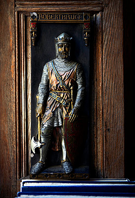Carved figure in window of Grade I listed Elizabethan manor house in Kent  - p349m789808 by Brent Darby