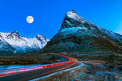 Light Trails & Full Moon, Finnbyen,  Lofoten Islands, Norway - p651m2033194 by Tom Mackie