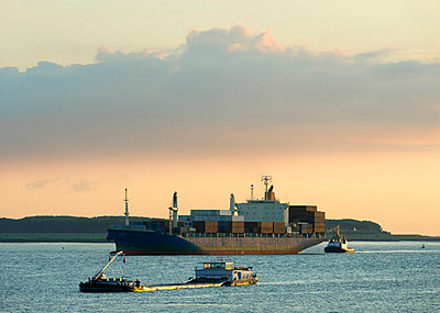 Container ship sailing on river - p429m696231f by Mischa Keijser