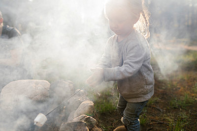 Girl (2-3) roasting marshmallow over campfire, Wasatch Cache National Forest - p1427m2213547 by Jessica Peterson