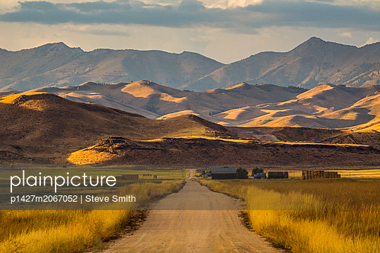 Road to mountains in Fairfield, Idaho - p1427m2067052 by Steve Smith