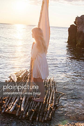 Woman on raft - p956m899016 by Anna Quinn