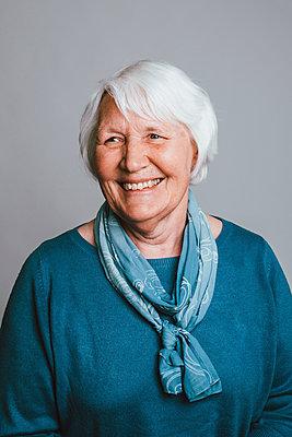Portrait happy senior woman - p301m2213602 by Toby Mitchell