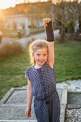 Girl with plastered arm - p312m2139342 by Anna Johnsson