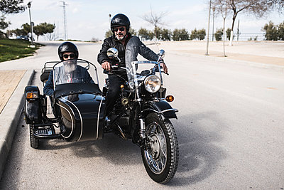 Two bikers standing on a road with their sidecar motorcycle - p300m1113614f by Jaen Stock