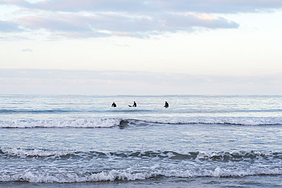Surfers in the Pacific Ocean from Tourmaline Beach. San Diego, CA. - p1436m2129082 by Joseph S. Giacalone