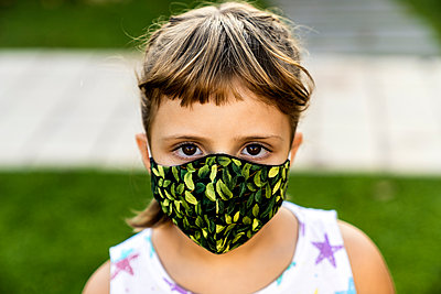 Girl with bangs wearing protective face mask outdoors - p300m2264609 by Albert Martínez